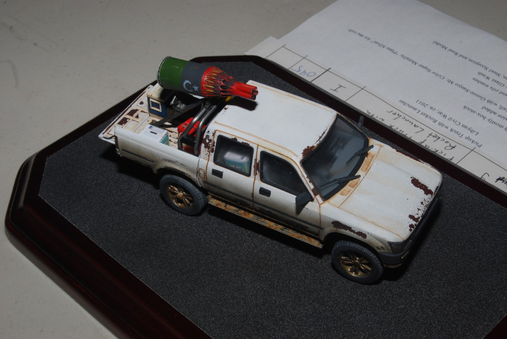 Militant-adapted civilian pickup truck with aircraft-typed rocket pod, by Randy Ray